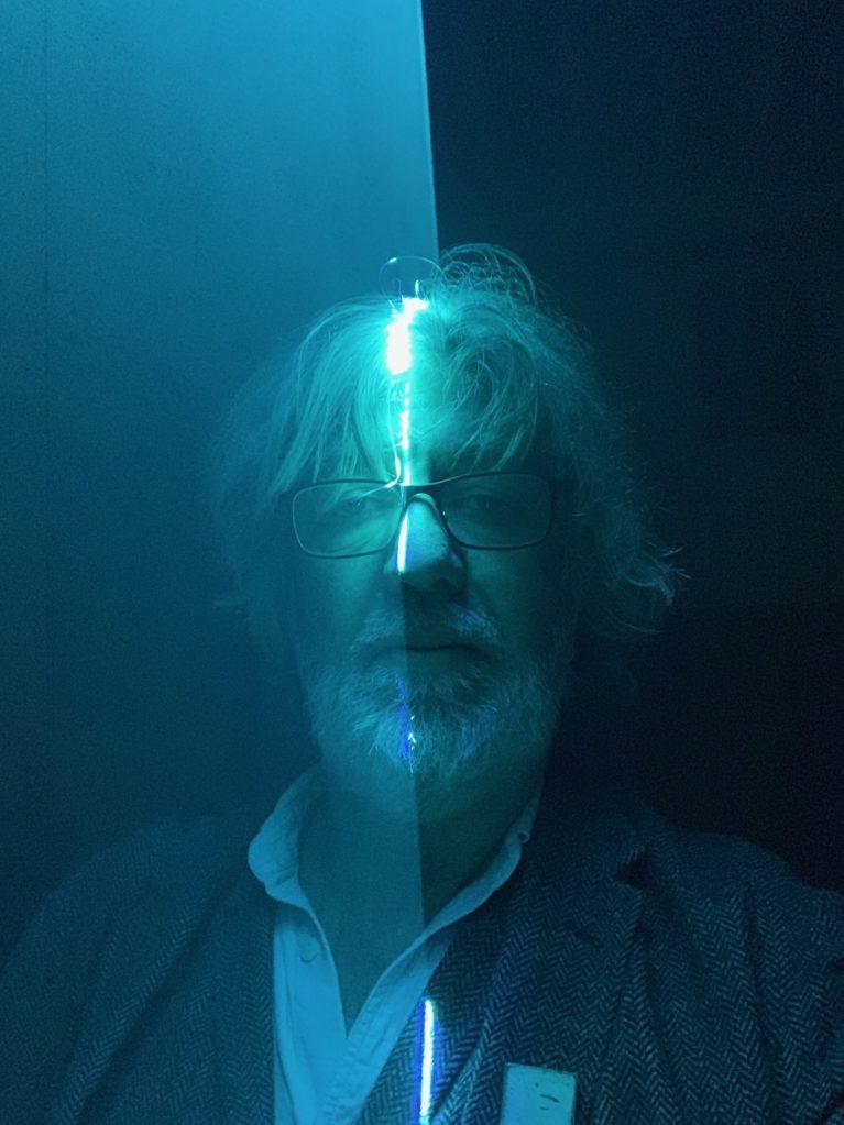 Bill Thompson in blue laser light
