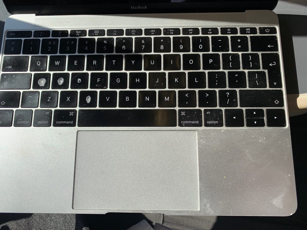 My MacBook Air, with worn keyboard
