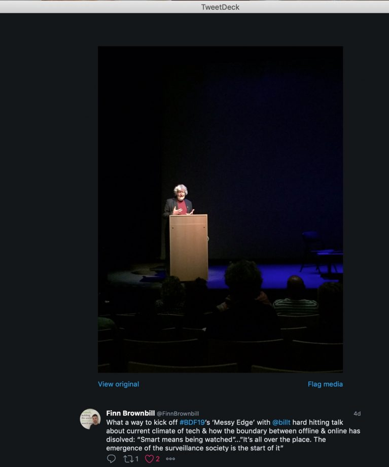 Tweet from @finnbrownhill about my talk, with picture of me at podium