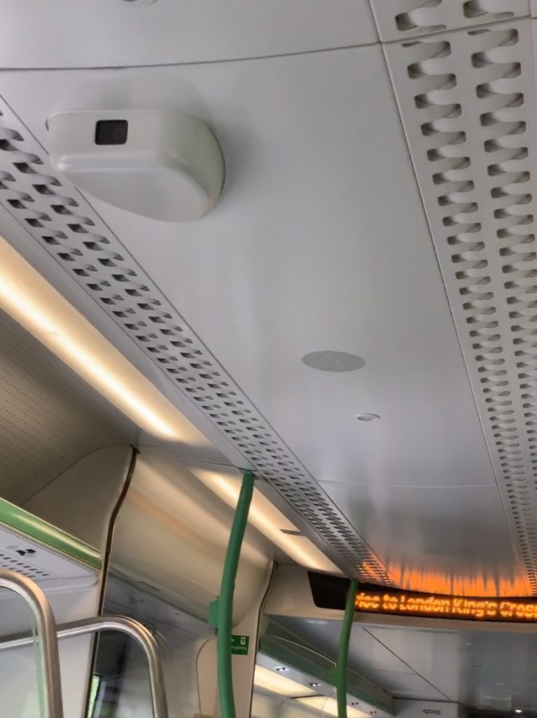 A surveillance camera on the Cambridge-London train